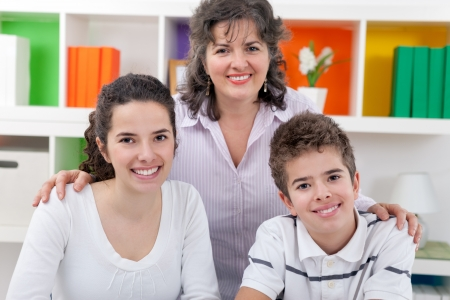 Portrait of happy mother with her son and daughter Stock Photo - 21259556