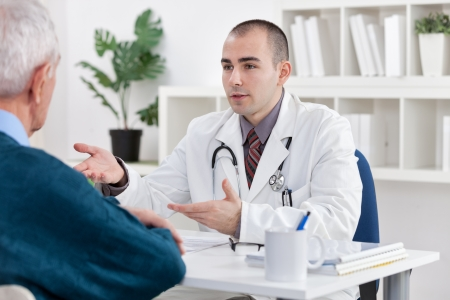 young doctor explaining diagnosis to his male senior patient