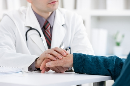 doctor's office: Doctor holding patients hand, helping hand concept  Stock Photo