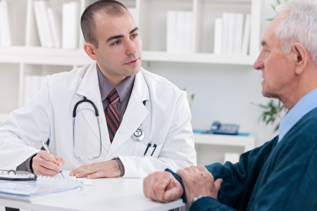 elderly patient: doctor explaining diagnosis to his male patient. Stock Photo