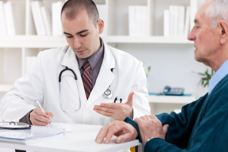 visit:  Portrait of handsome male doctor talking with senior patient