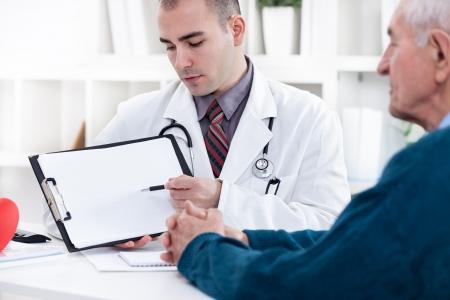 cardiologist: Cardiologist explaining his patient EKG results
