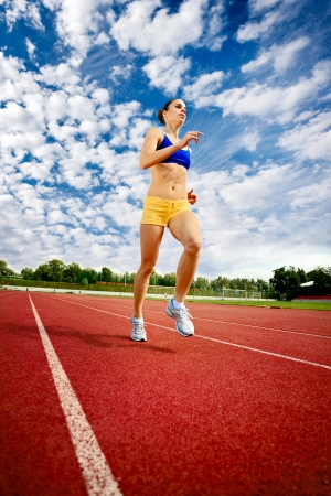 jogging track: beautiful young woman exercise jogging and running on athletic track Stock Photo