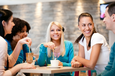 socializing: Happiness friends enjoying coffee together in modern  cafe