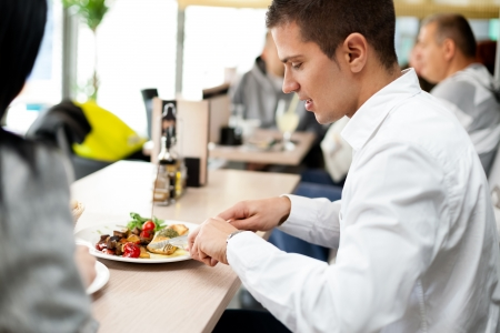 lunch meeting: young man dining with his partner in an restaurant