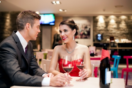 first date: romantic young couple on first date in restaurant Stock Photo