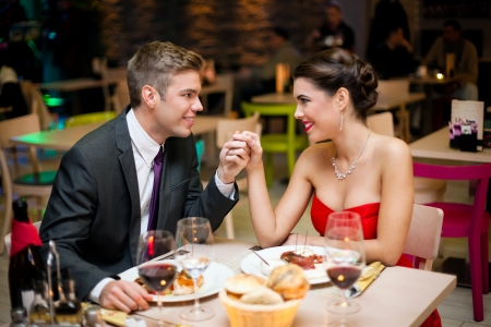 Young happy couple at the restaurant photo
