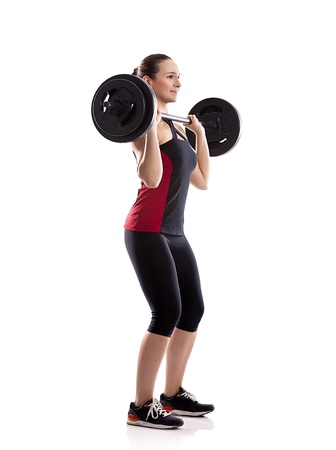 woman lifting weights: Woman pick up weight  on barbell, isolated over white background
