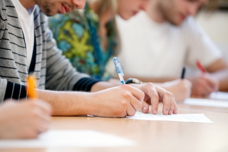 school exam:  writing hands of students at course Stock Photo