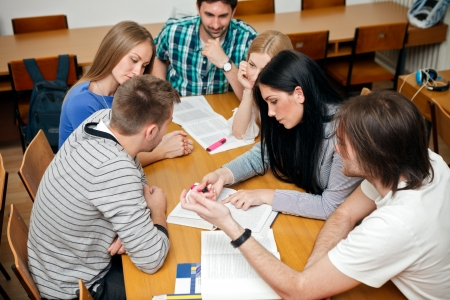 working together: group of student studying together
