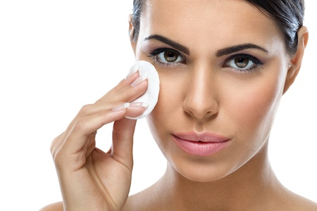 pimples:  skin care, young woman cleaning her face with cotton pad