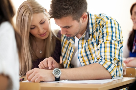 high class:  Young students couple working together