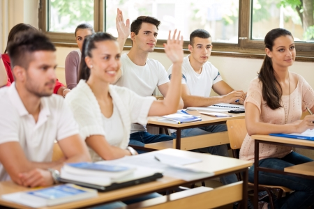 working class:  Students in class asking questions to the teacher