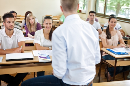 teacher lecturer  his students in classroom