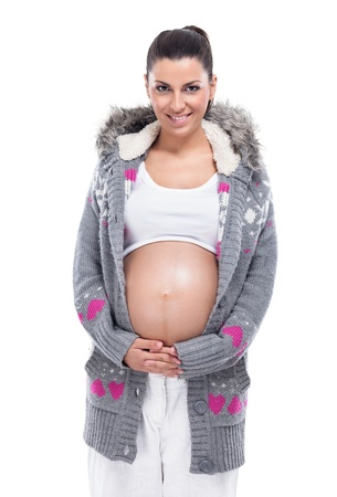 Young pregnant woman in sweater with naked belly Stock Photo - 21875951