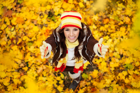 view woman: Happy smiling girl in autumn park, top view Stock Photo