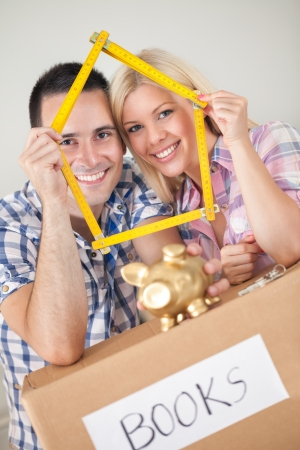 Young couple buying new home  concept saving for new home  photo