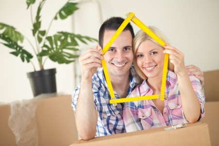 first home: Happy smiling couple moving into first new home