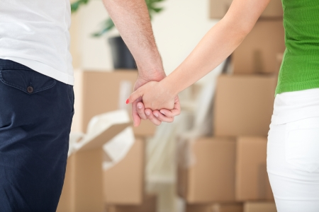 Couple holding hands together while moving into a new house Stock Photo - 22631632