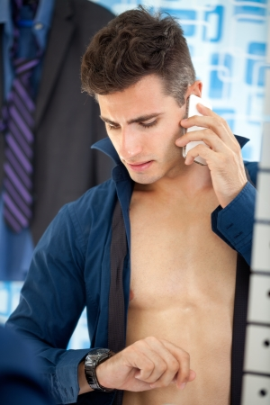 Busy young businessman in morning  preparing for work photo