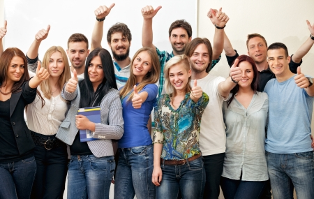 Group of happy students at classroom photo