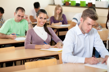 amphitheater:  Beautiful student girl in classroom full of students Stock Photo