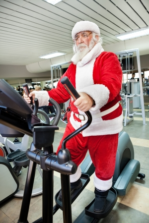 Santa Claus  doing exercises before delivering presents photo