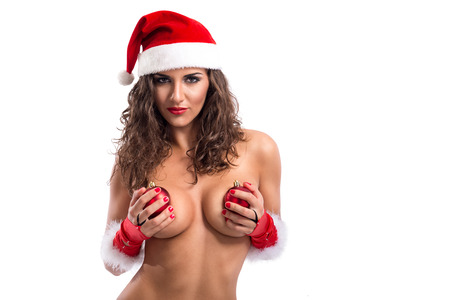 Provocative nude woman with Christmas balls and santa hat photo