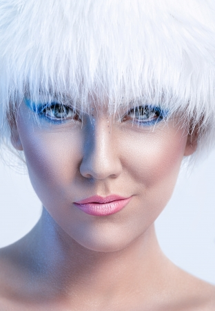 Cute winter woman with fur hat, close up photo