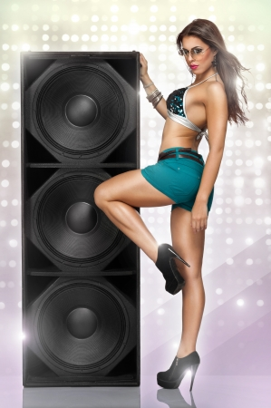 erotic young party girl enjoying in music  photo