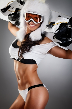 hot sexy girls: Seductively dressed woman posing with snowboard