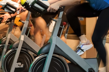 stationary bike:  People doing sport Spinning in the gym for fitness Stock Photo