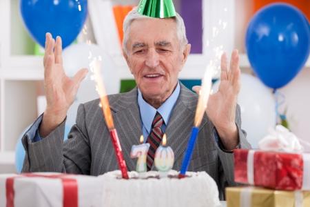 Happy senior man celebrating 70th birthday Stock Photo - 23961920
