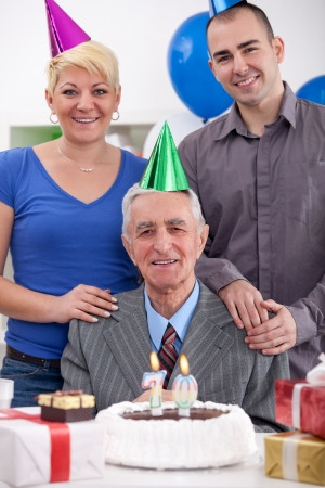70 year old man: Senior man celebrating his 70th birthday with family