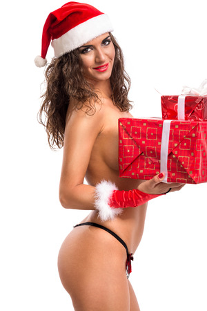 hat nude: Beautiful nude Christmas woman in santa hat with gift box