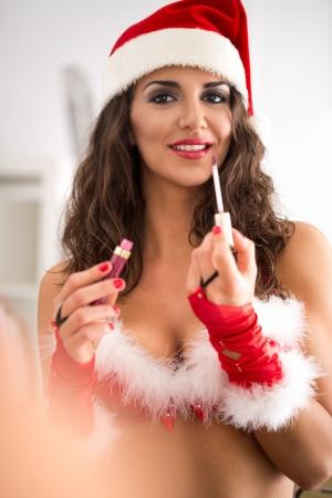 Lovely Santa woman make up, reflection of mirror photo