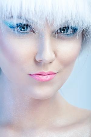 Close up of beautiful girls face, with winter makeup photo