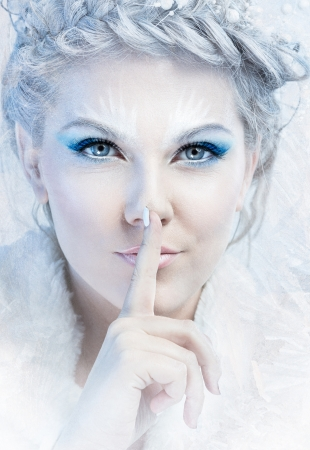 snow queen with a finger over mouth photo