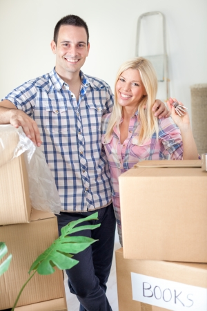 key to freedom:  Portrait of happy couple in their new home Stock Photo
