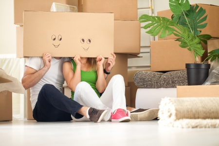Couple with empty boxes on heads with smiley on it  photo