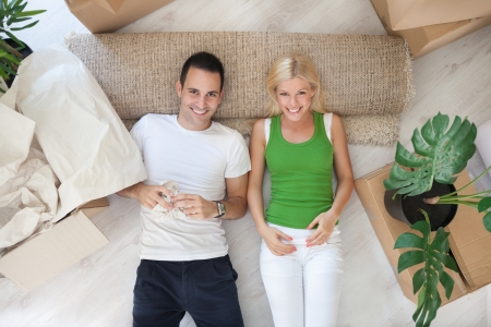 Young couple resting on floor their new home photo