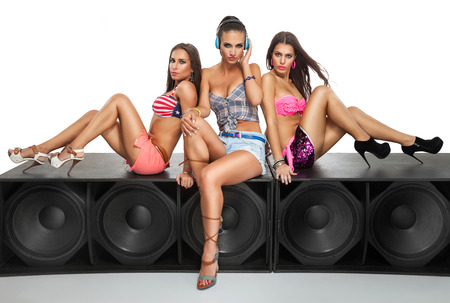 Sexy girls friends sitting on large speaker photo