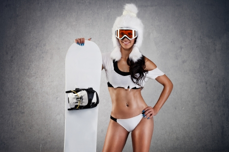 sports clothing:  Sexy young female snowboarder Stock Photo