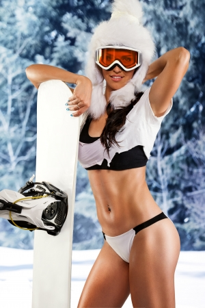 naked girl: young passionate sportswoman with snowboard