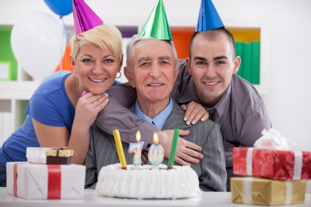 70 year old man:  Portrait of happy family celebrating birthday together