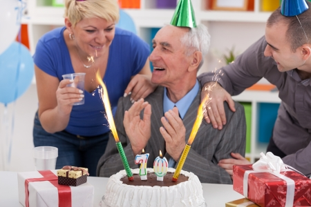 70 year old man: Senior man celebrating birthday with his family