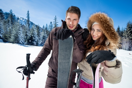 couple on ski holiday in mountains photo