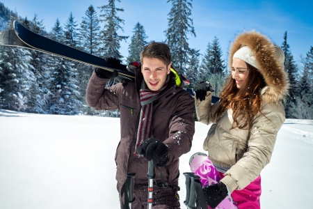 happy couple in the mountains for ski vacation photo