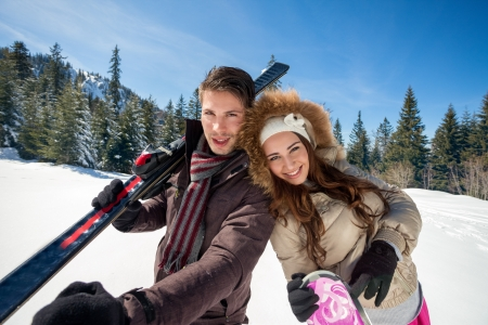 Happy couple on ski vacation photo
