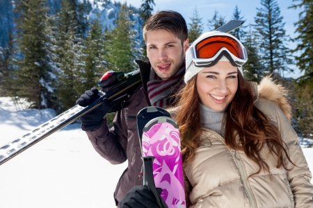 Portrait of happy couple with skis photo